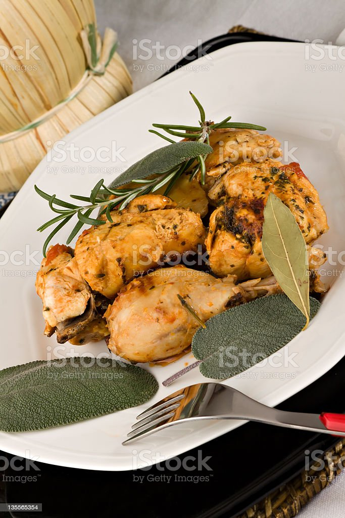 Chicken, stewed in tomato, wine and herb sauce royalty-free stock photo