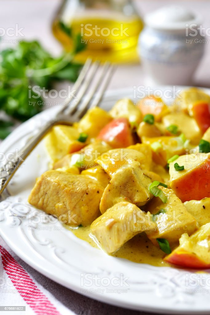 Chicken stewed with apple stock photo