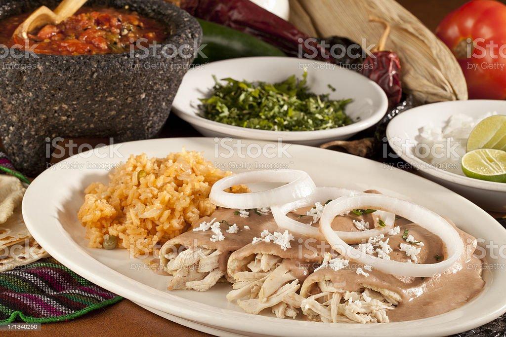 Chicken Tacos With Beans Gravy or Enfrijoladas stock photo