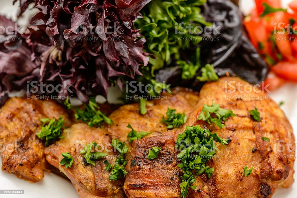 Chicken Thighs and Salad stock photo