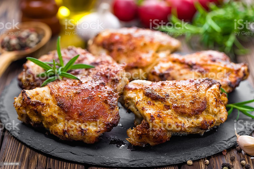 chicken thighs stock photo