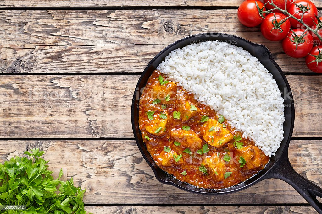 Chicken tikka masala Asian traditional spicy meat food and rice stock photo