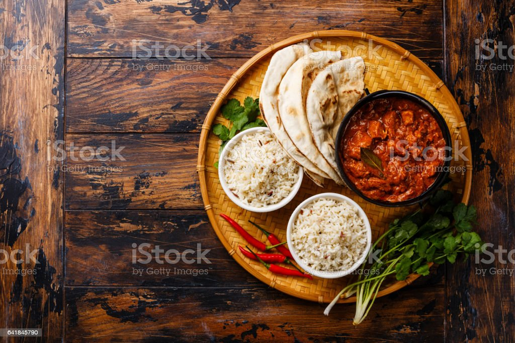 Chicken tikka masala spicy curry meat with rice and bread stock photo