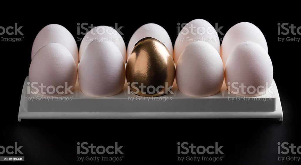 chicken white and golden eggs stock photo