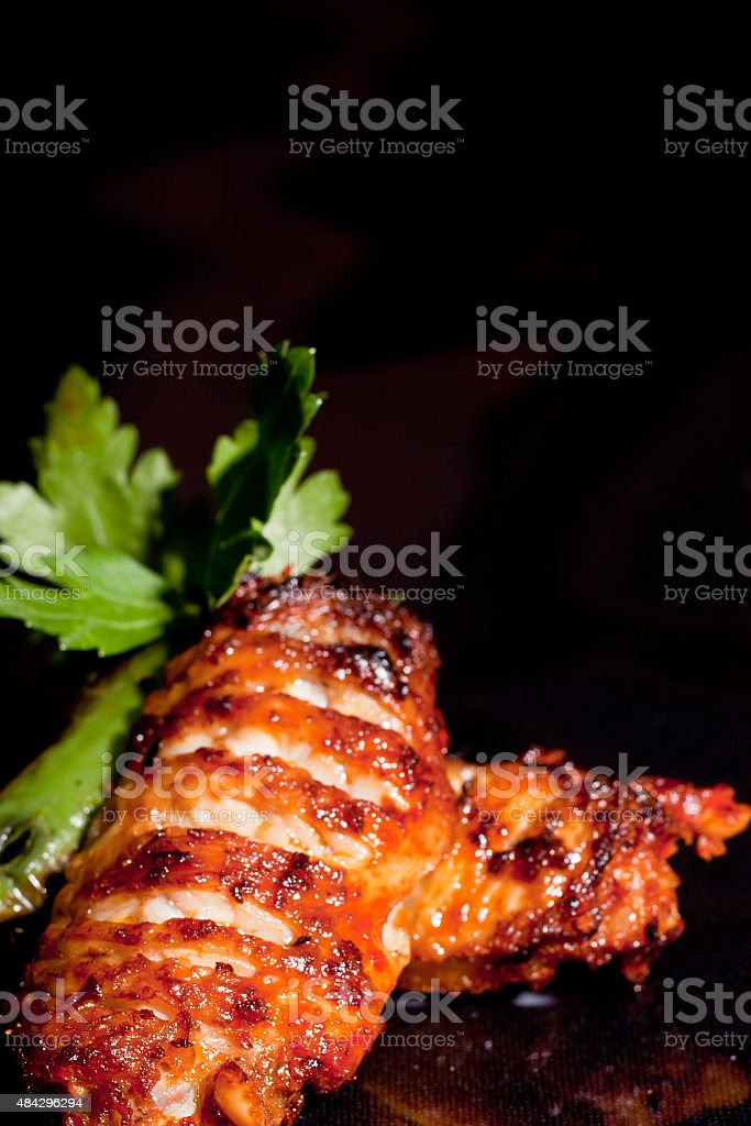 Chicken wings and parsley stock photo
