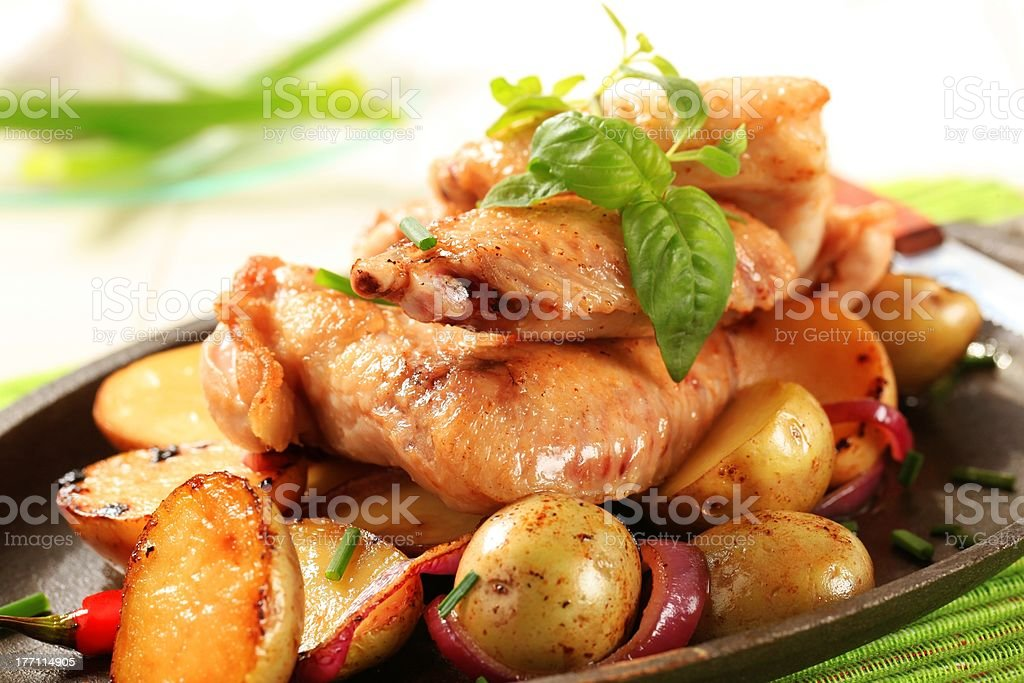Chicken wings and potatoes royalty-free stock photo