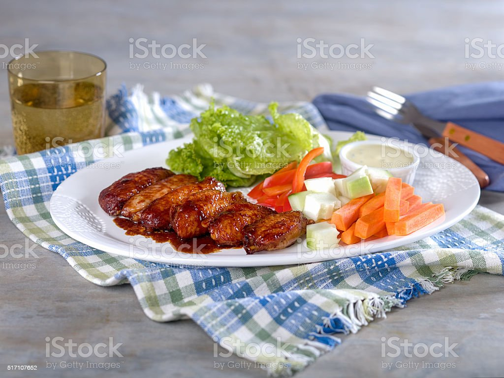 Chicken Wings and Vegetables with Dip on Platter stock photo