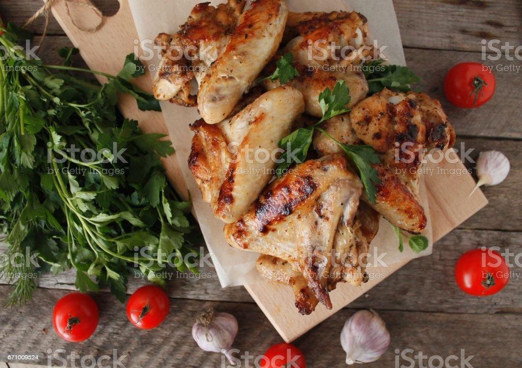 Chicken wings in on wood board stock photo