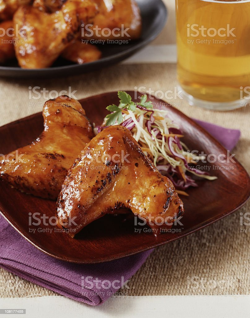 Chicken Wings on Plate with Beer in Background royalty-free stock photo