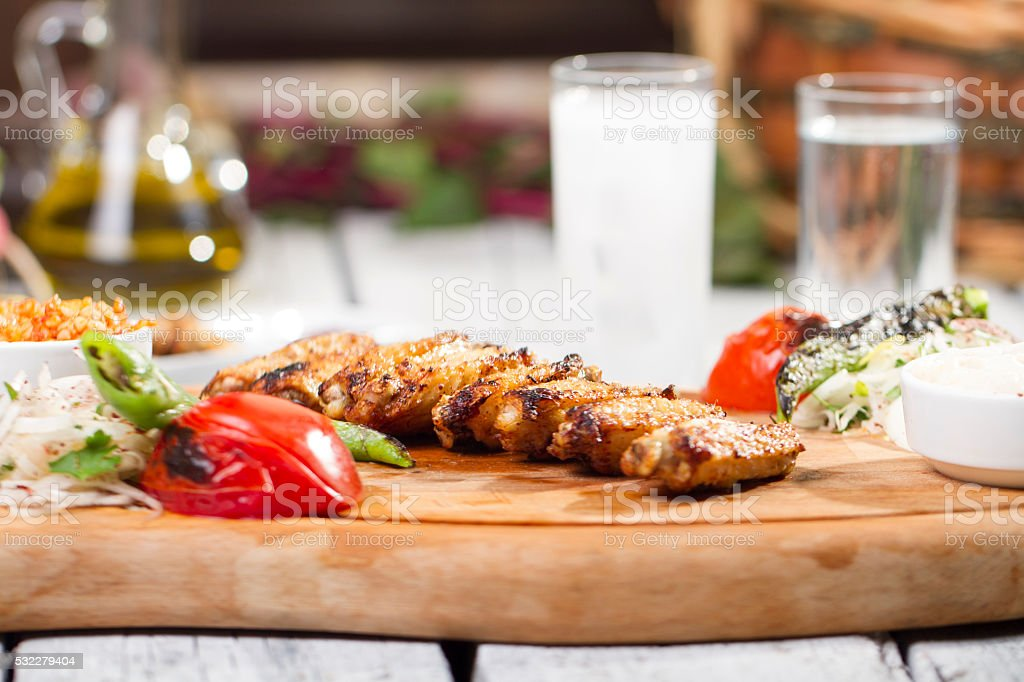 Chicken wings with sriracha sauce on wooden table stock photo