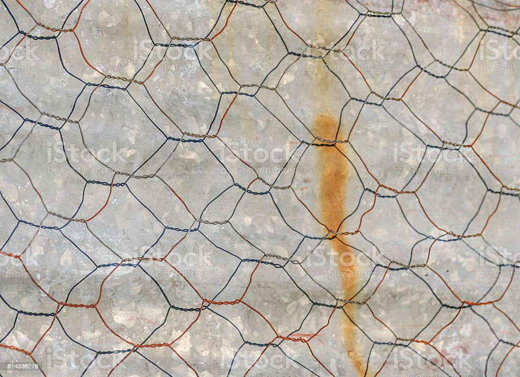 Chicken wire casting shadow stock photo