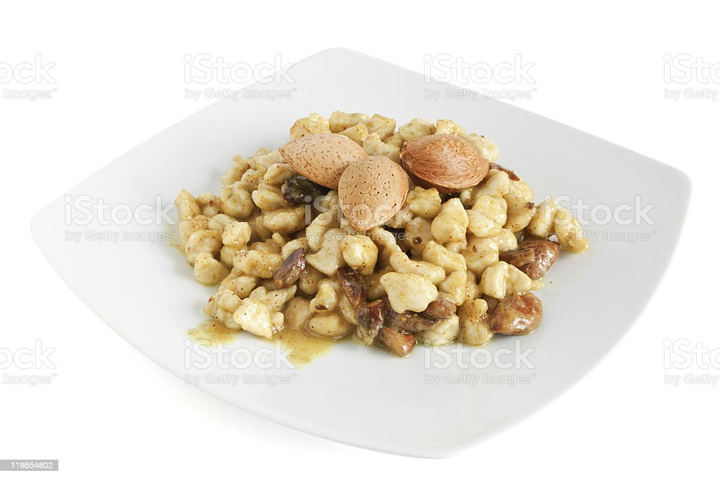 chicken with almonds and curry stock photo
