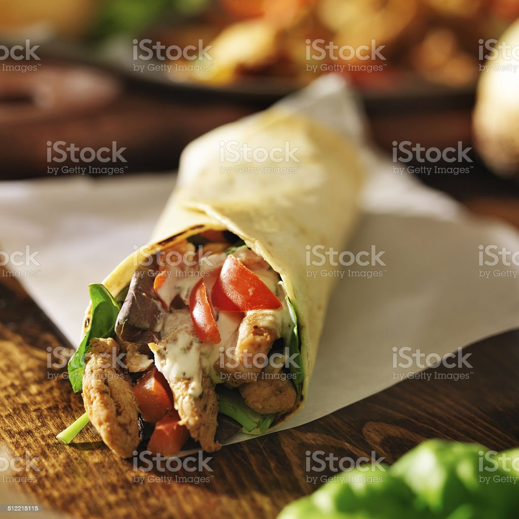 chicken with in tortilla with red peppers stock photo