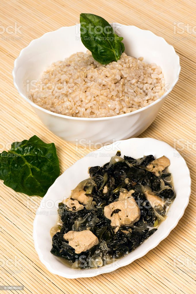 chicken with mangold and a bowl of rice stock photo