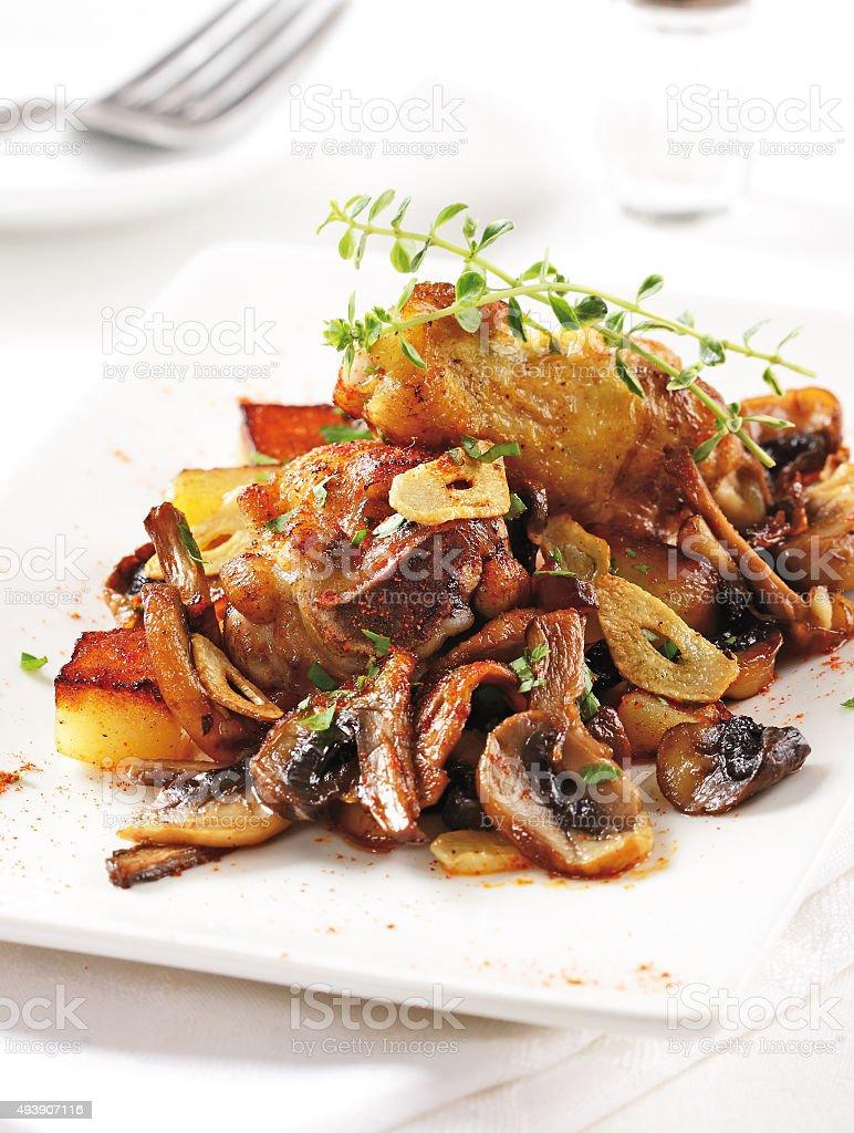 Chicken with mushrooms and garlic stock photo