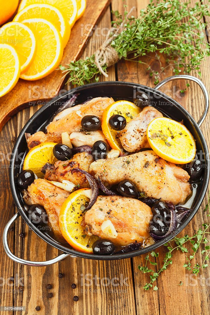 Chicken with oranges and olives stock photo