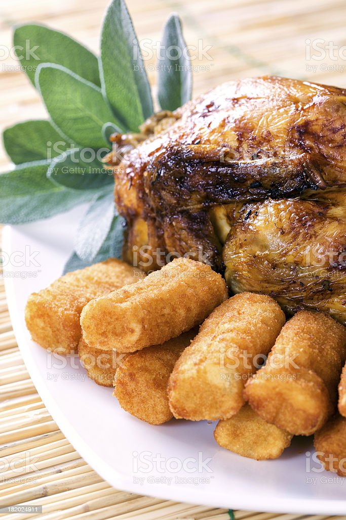 Chicken with potato croquettes stock photo