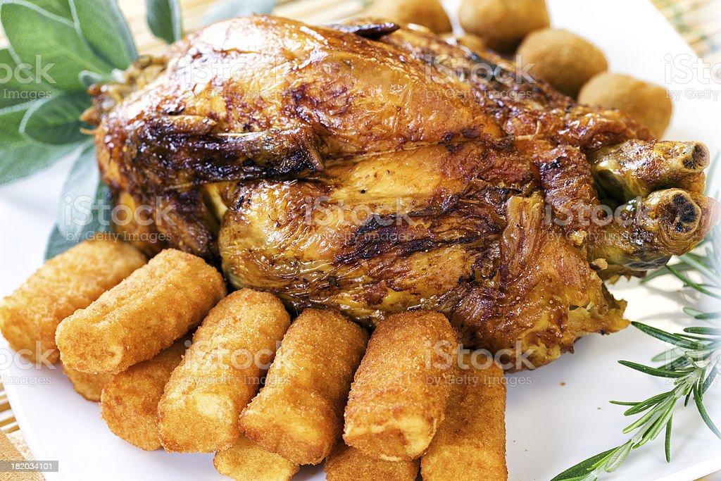 Chicken with potato croquettes stock photo