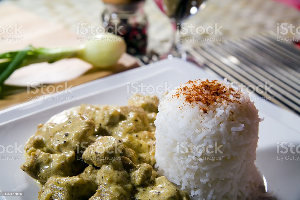 chicken with rice in curry spice stock photo