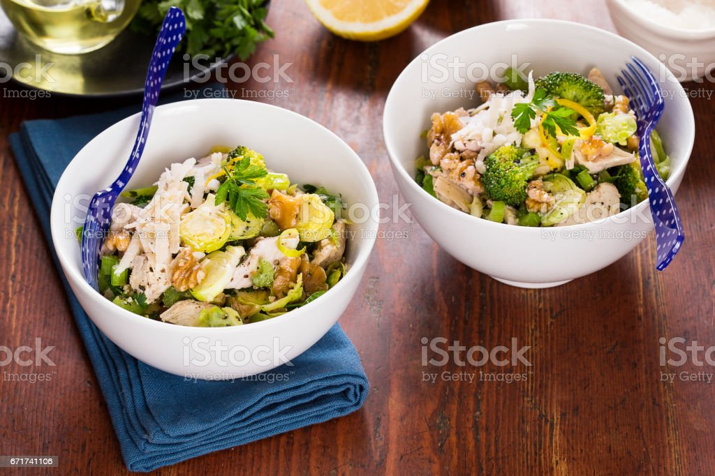 Chicken with sprouts walnuts parmesan stock photo