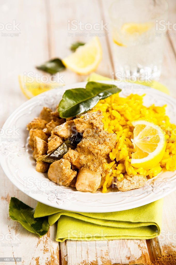 Chicken with turmeric rice stock photo