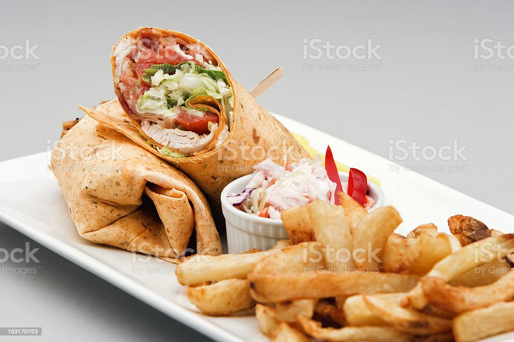 Chicken Wrap and french fries royalty-free stock photo