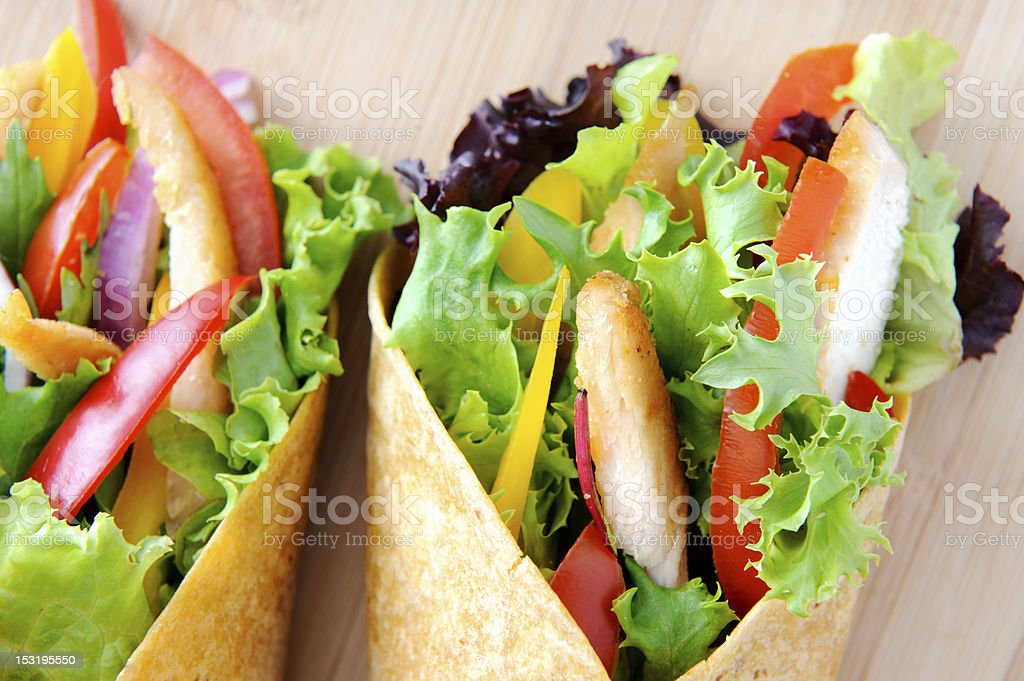 Chicken wrap salad on a wood background royalty-free stock photo