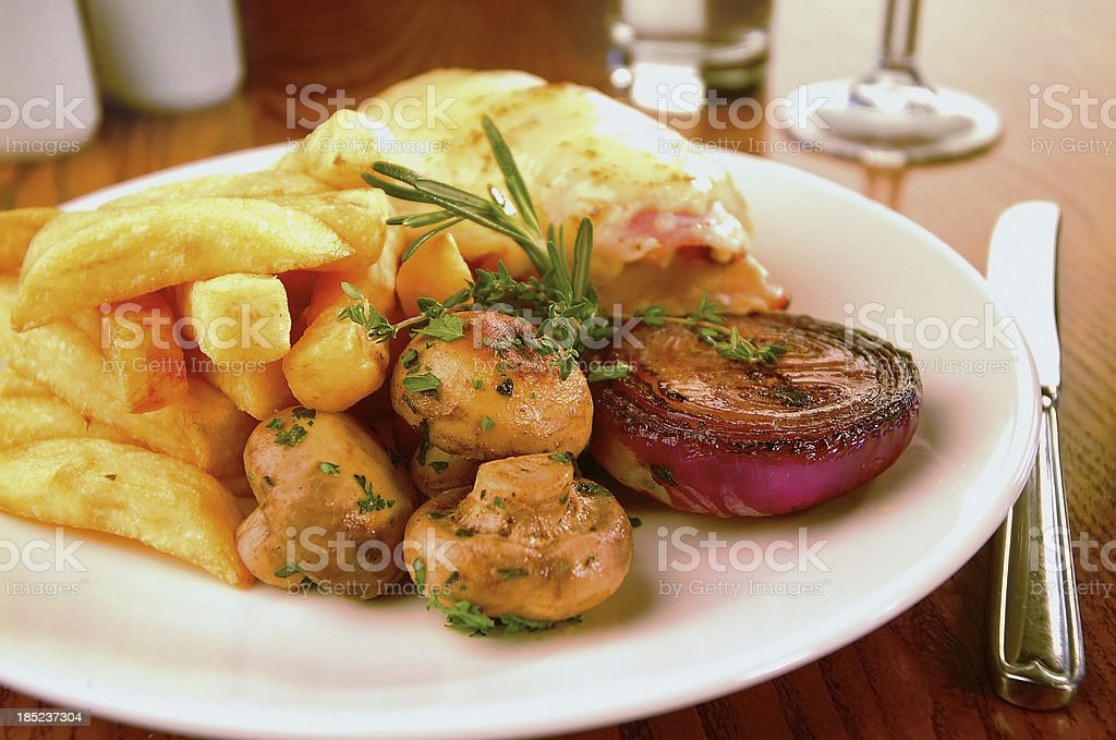 Chicken wraped in bacon, cheese with fries and champignons royalty-free stock photo