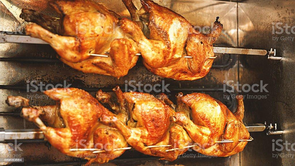 Chickens roasting in rotisserie. stock photo