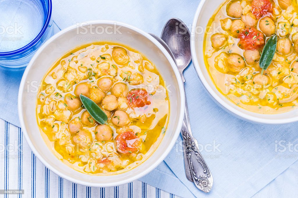 Chickpea, beans and barley soup. stock photo