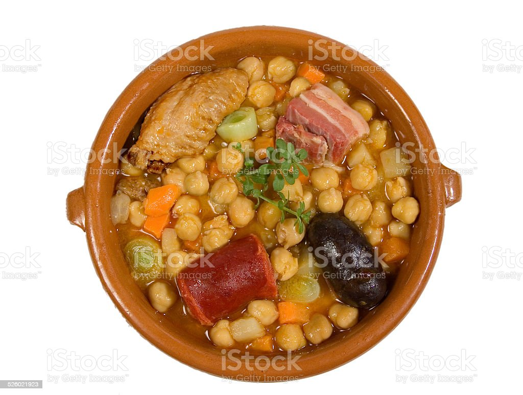Chickpea dish with meat, bacon and chicken stock photo