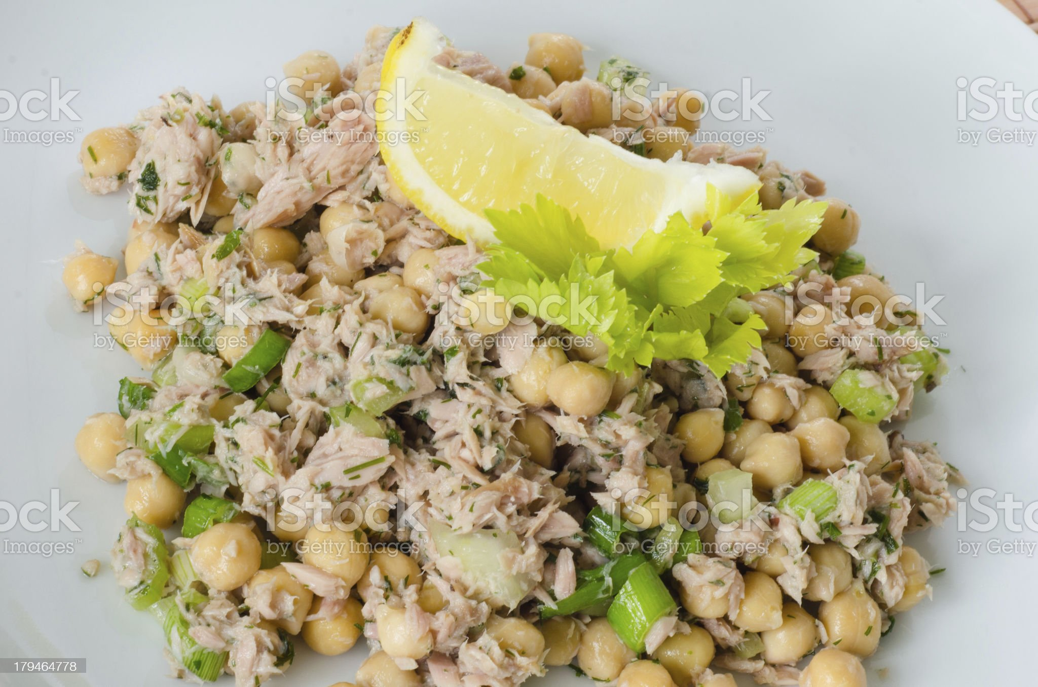 Chickpea salad with tuna, lemon and herbs royalty-free stock photo