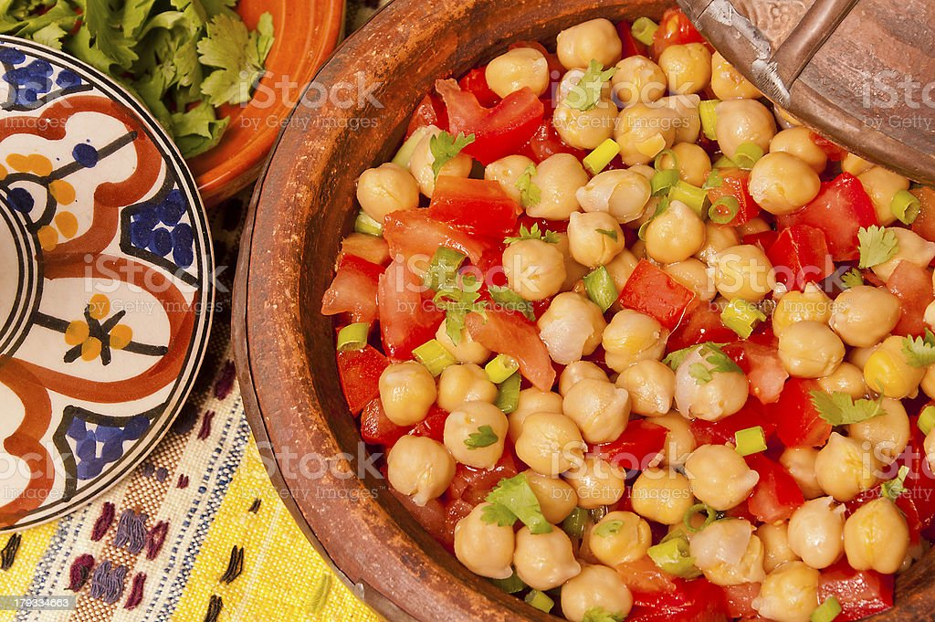 Chickpeas and tomato salad royalty-free stock photo