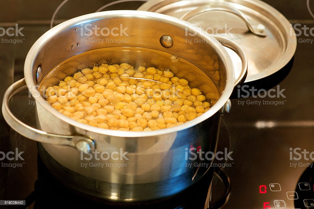 chickpeas cooked in a pan in kitchen stock photo