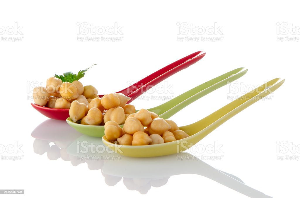 chickpeas over spoons stock photo