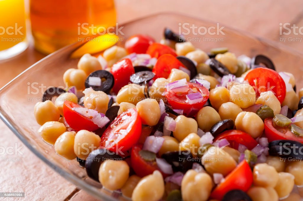 chickpeas with tomatoes and black olives stock photo