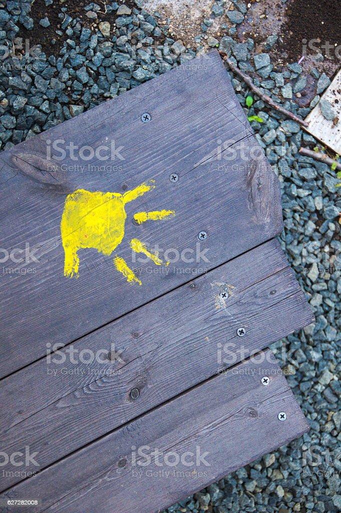Chid's Yellow Handprint on Wood stock photo