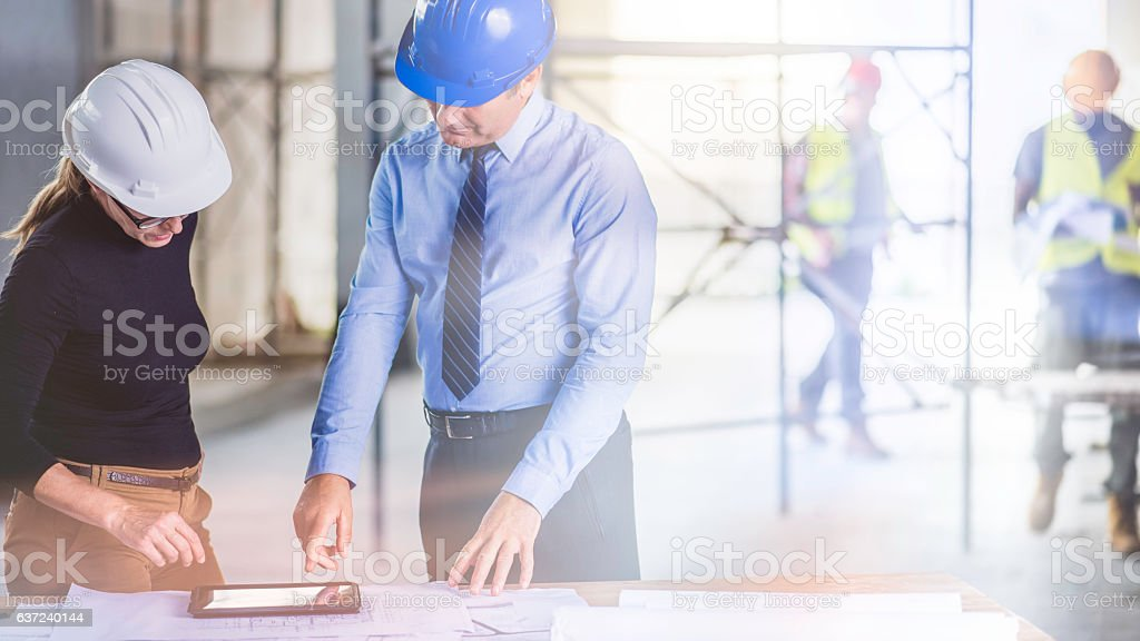 Chief constructor and female architect stock photo