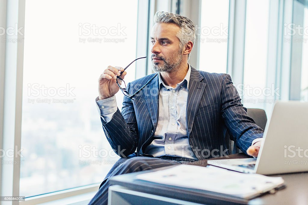 Chief executive looking through the window stock photo