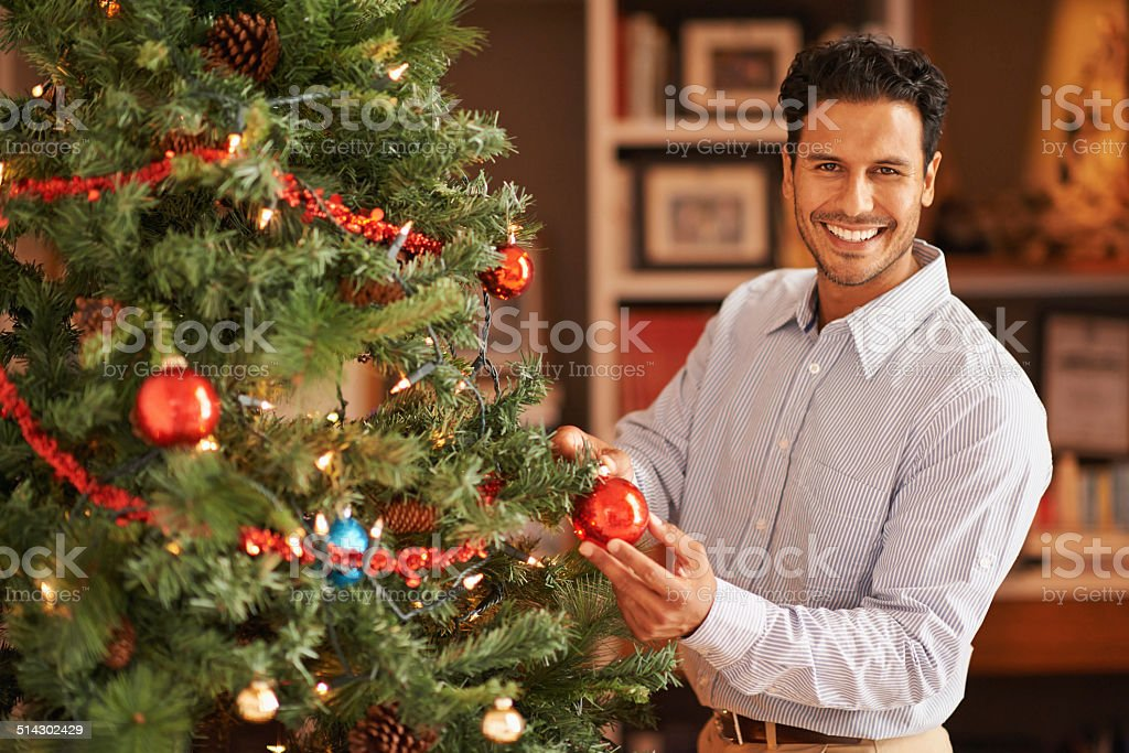 Chief in charge of christmas tree decorations stock photo