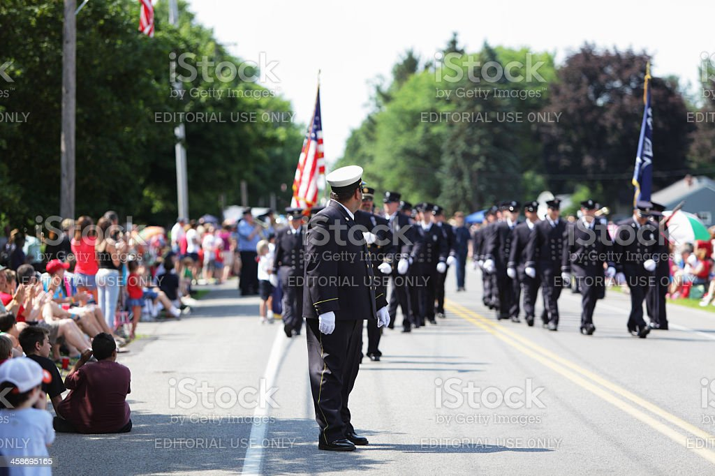 Chief Leads Fire Department Parade Marchers stock photo