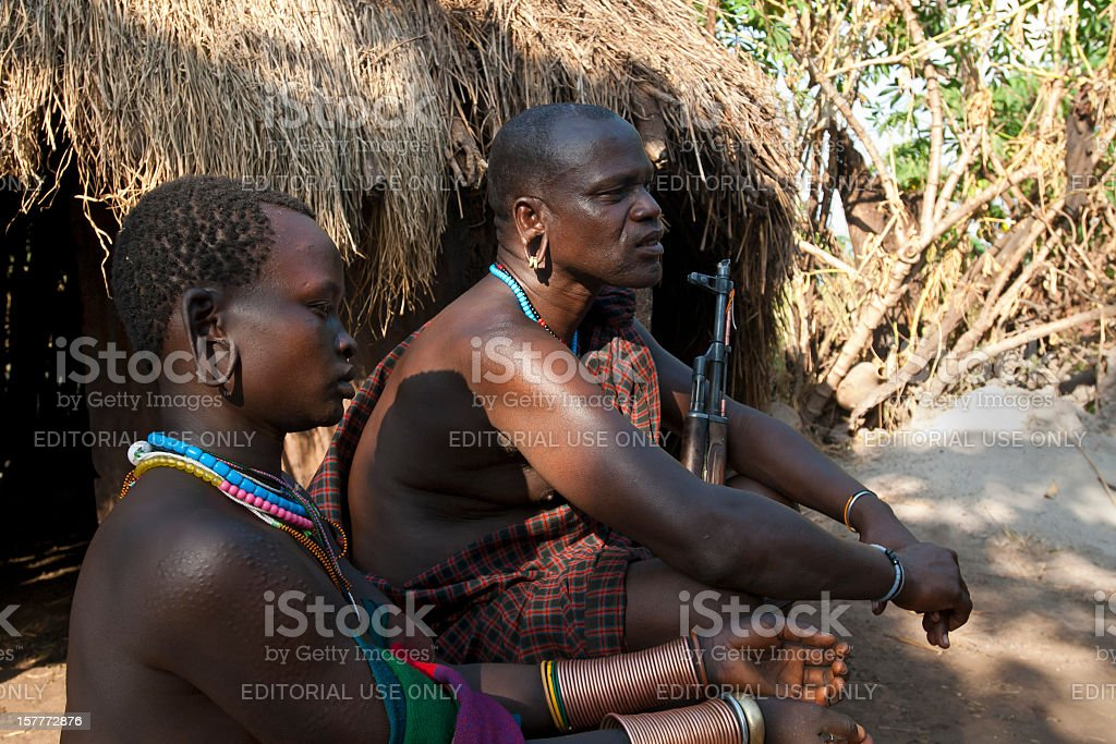 Chief of the village and his wife, Surma, Southern Ethiopia stock photo