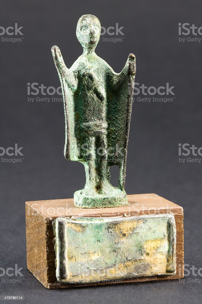 Chieftain praying with cloak and stick, bronze figurine stock photo