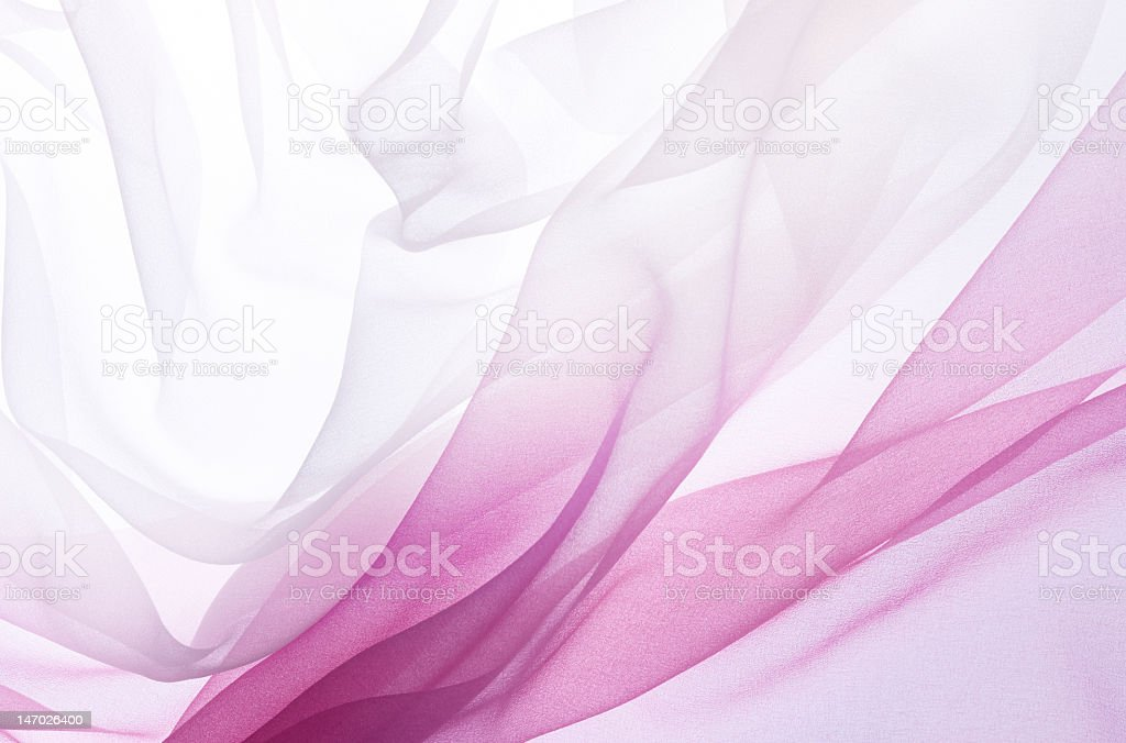 Chiffon in pink and white gradient colors flying stock photo