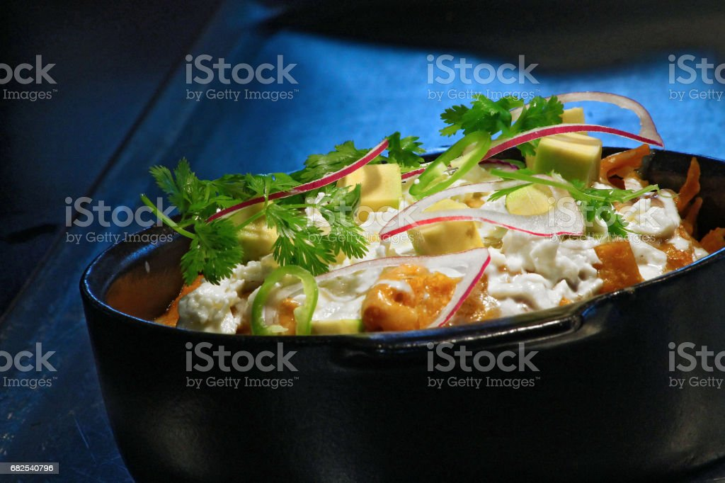Chilaquiles with dark background stock photo