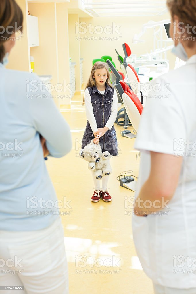 Child afraid of the dentist stock photo