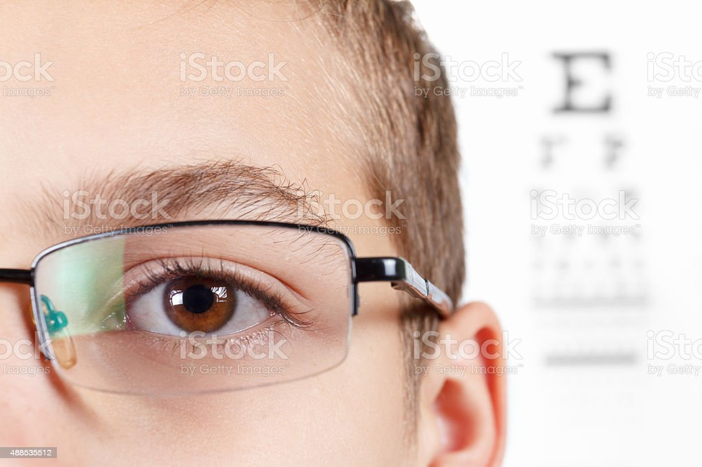 Child an ophthalmologist .Portrait of a boy with glasses. stock photo