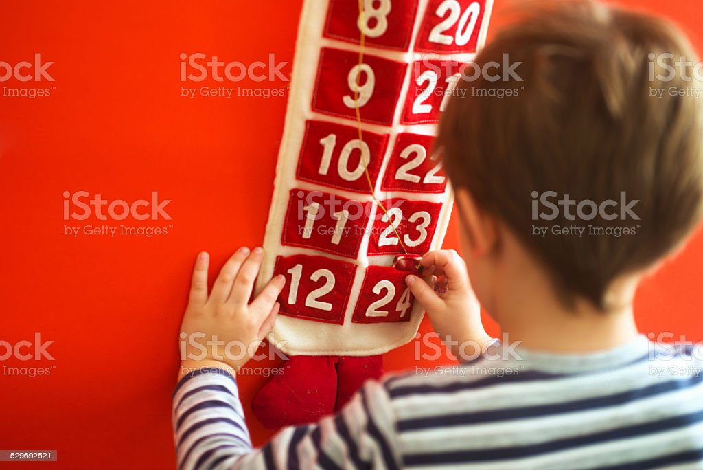 Child and Advent Calendar stock photo