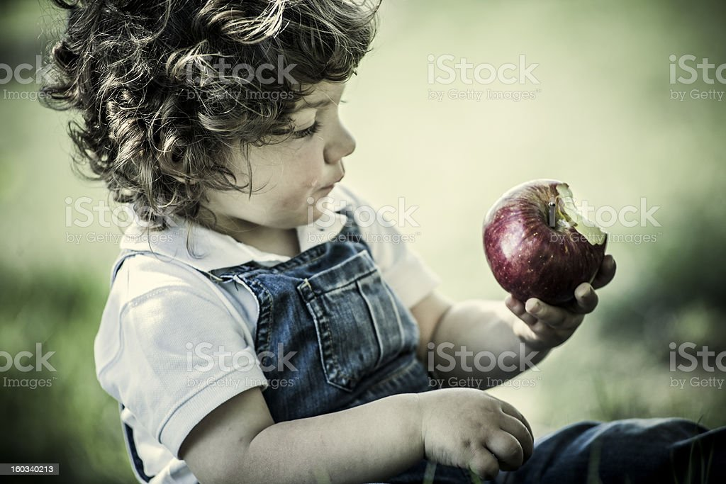 child and apple royalty-free stock photo