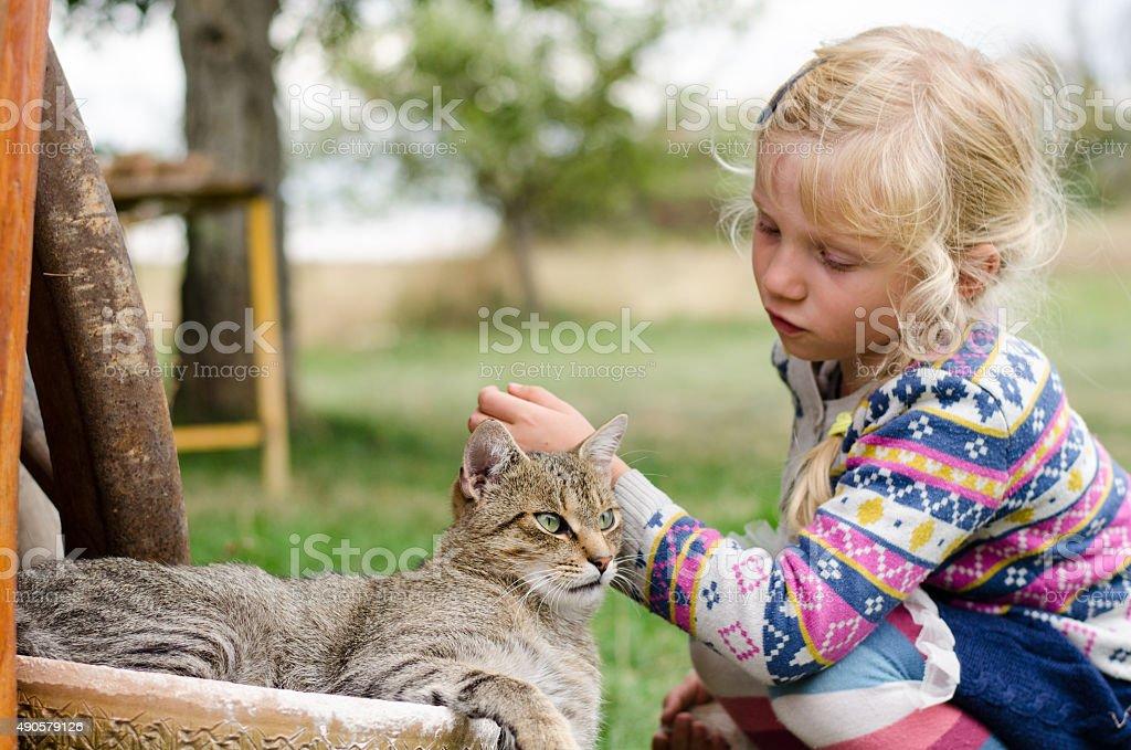 child and cat stock photo